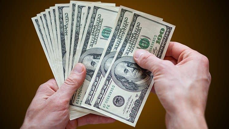 Qual o papel do Dinheiro